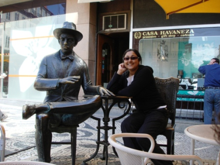 Becca and a statue in Lisbon